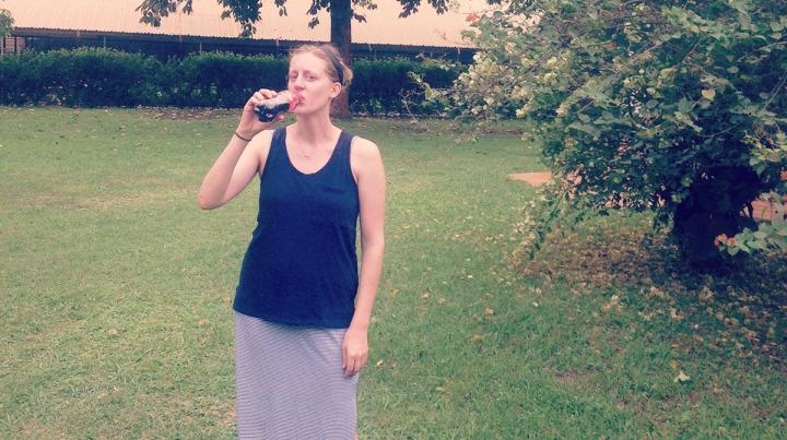 Sarah drinking Coca-Cola